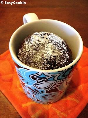 low fat microwave mug cake on an orange mat