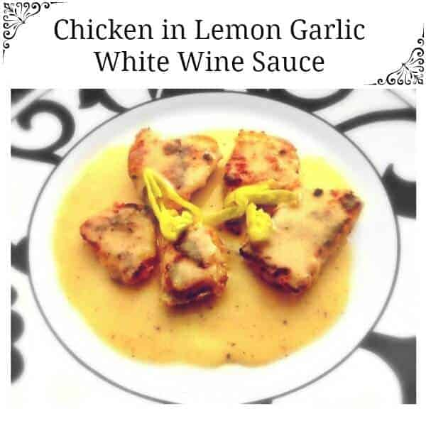 chicken with white wine in a whit-black plate