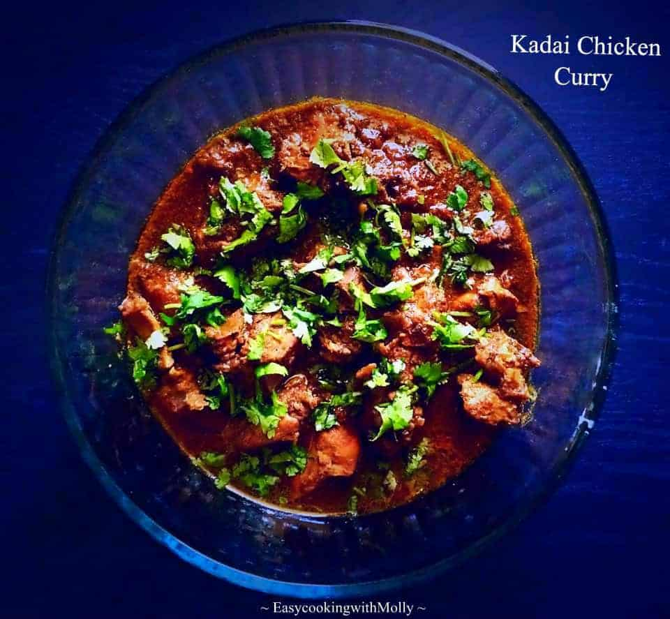 kadai chicken curry in a bowl with shopped cilantro on top