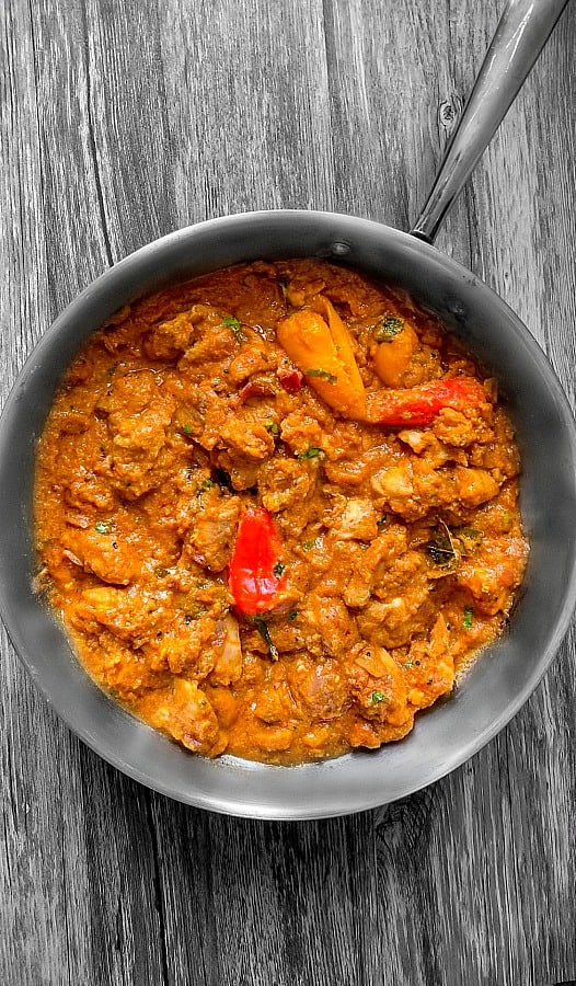 cooked Achari Chicken in a large pan