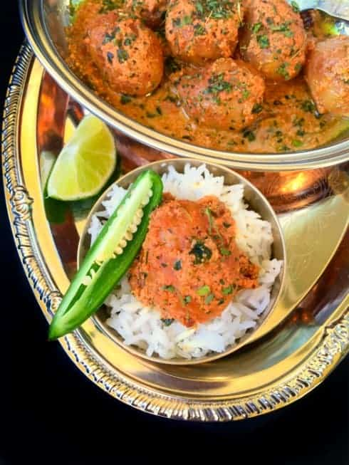 Kashmiri Dum Aloo in a platter with rice.