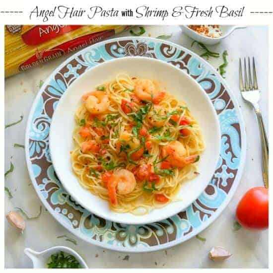 angel hair pasta with shrimp recipe on a white and blue plate