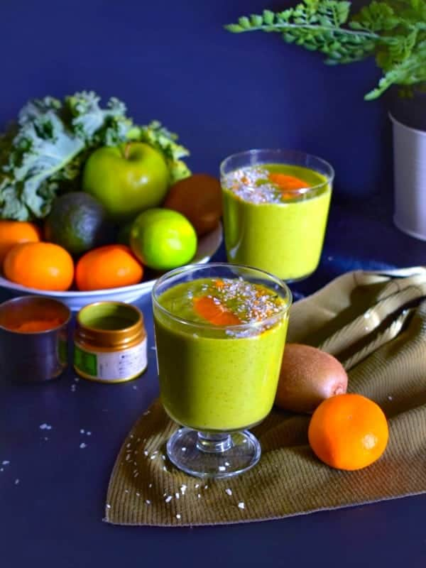 Loaded immunity boosting green smoothie recipe with fruits around it