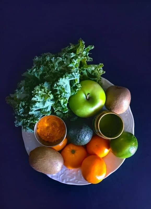 immunity boosting smoothie ingredients like apple, oranges, kiwi, avocado, turmeric