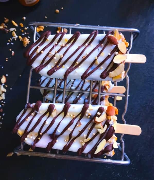 Chocolate Yogurt Breakfast Popsicles on a steel stand