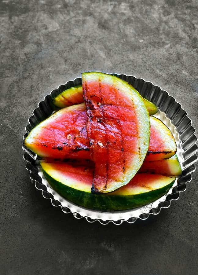 grilled watermelon slices in a silver plate for margarita recipe