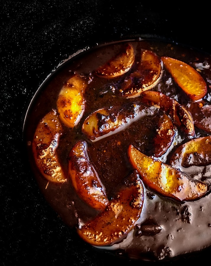peach ginger-bbq sauce in a skillet with chopped peaches