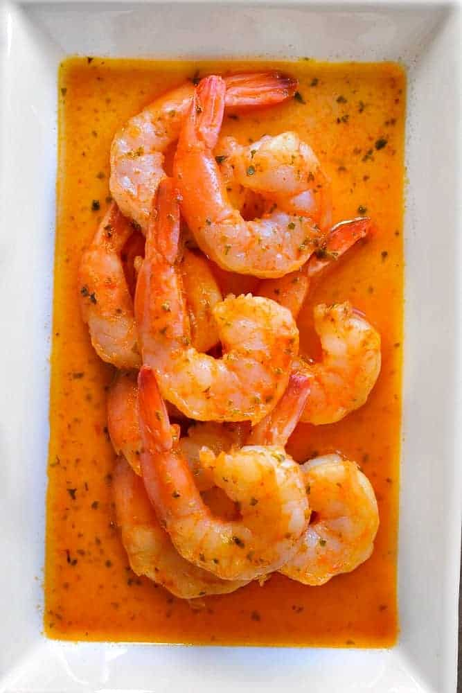 spicy shrimp scampi in a white plate