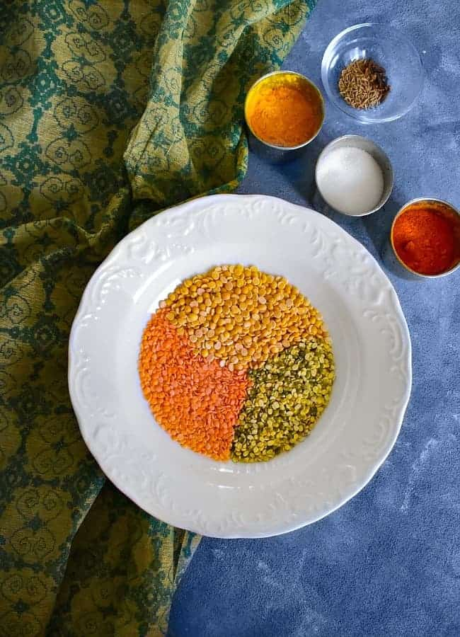 Instant Pot Dal Ingredients like lentils and spices on blue board