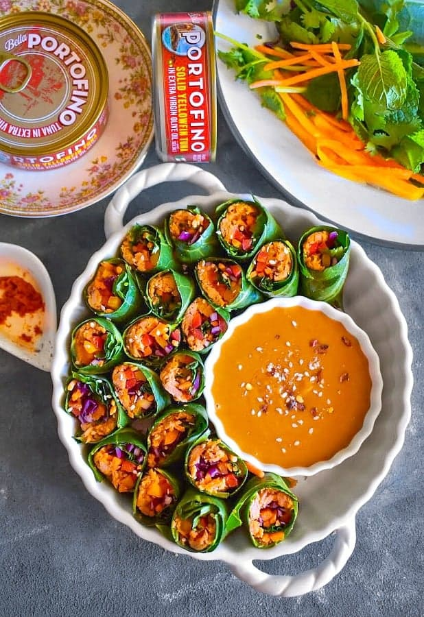 Thai Vegetable Tuna Rolls in a white bowl with peanut sauce