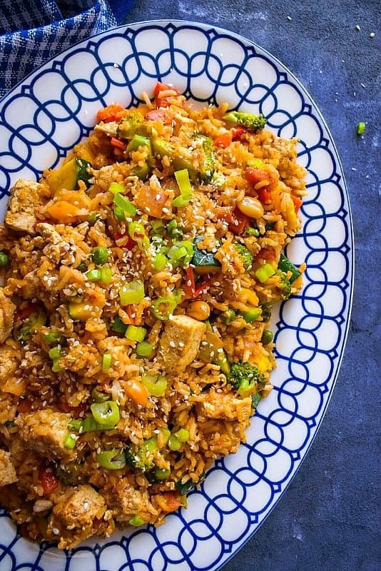 quick tofu fried rice on a white blue plate