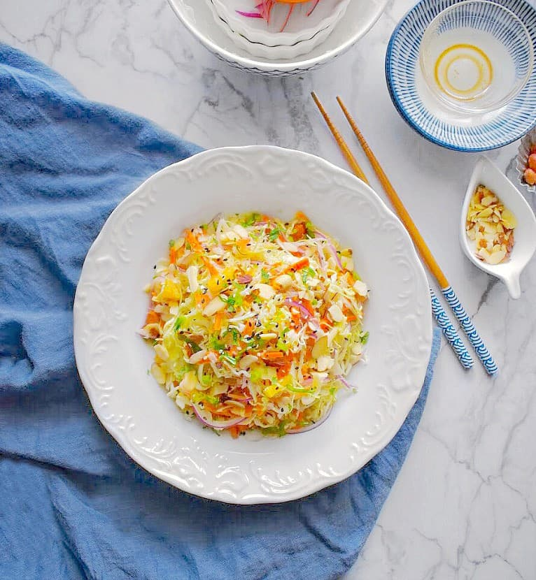 warm detox cabbage salad on a white plate