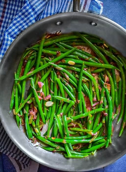 sauteed green beans almonds in a pan