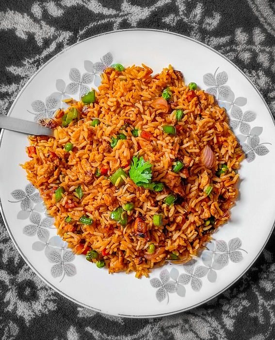 easy chicken fried rice on a white plate with black background