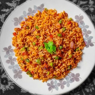 quick easy chicken fried rice on a white plate with black background