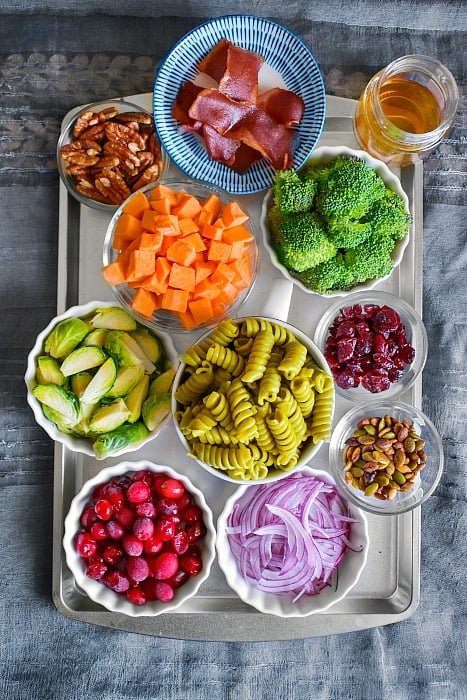 Easy Fall Pasta Salad Ingredients on a blue background