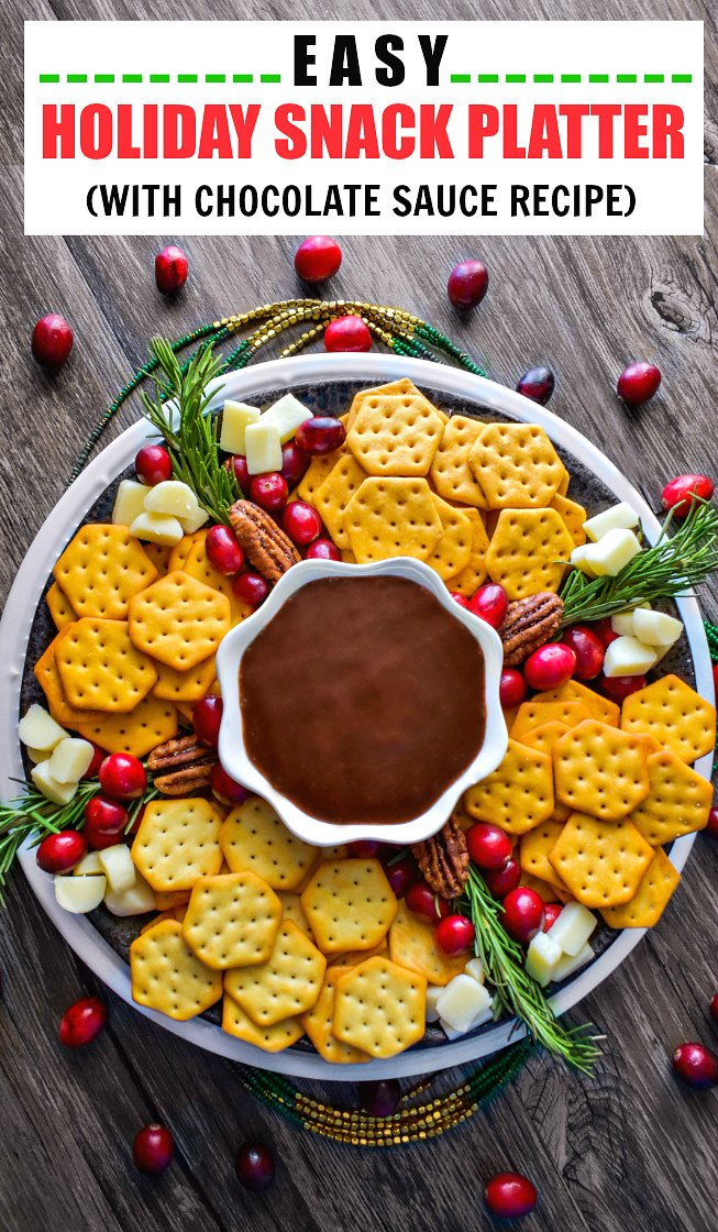 Easy Holiday Snack Platter using cheese crackers, chocolate sauce, cranberries and cheese